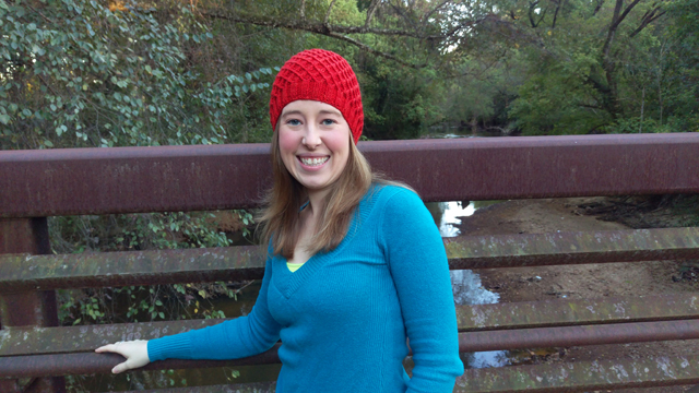 A snug fitting beanie with an all-over web of baby cables
