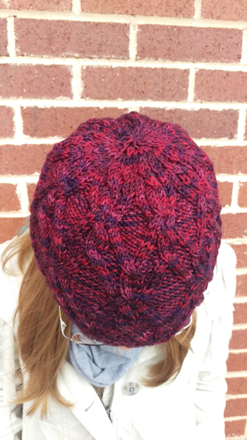A cabled beanie in tonal yarn