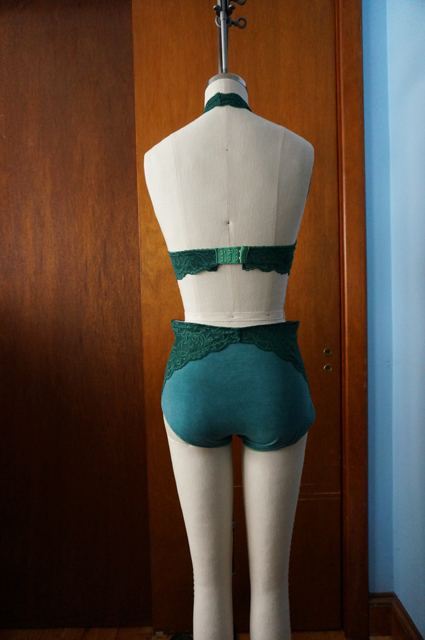 Back view of dress form displaying a lace halter bralette and high-waisted underwear with lace side panels
