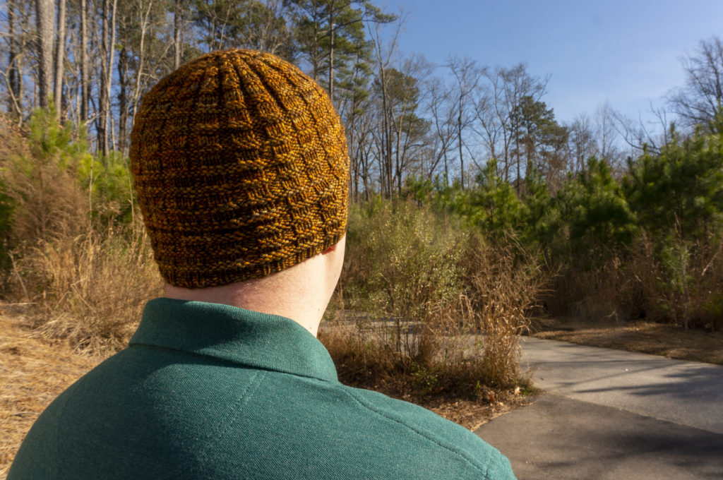 A golden-brown hat with a waffle-like knit-purl texture